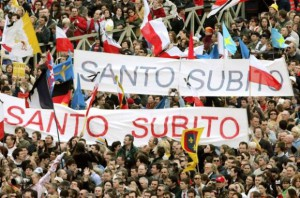 File photo of mourners holding a banner during a funeral Mass for Pope John Paul II in St Peter's Square in Vatican City